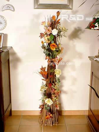 Bundle of twigs decorated for Christmas with iridescente flowers and leaves