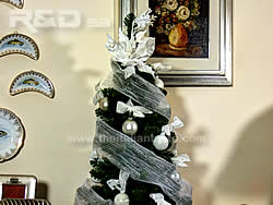 Christmas tree decorated with white fabric strips and balls