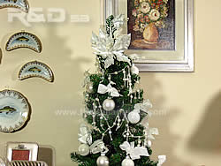 Christmas tree decorated with white balls, bows and crystal chains