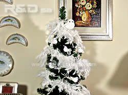 Christmas tree decorated with white feather boa and birds