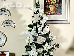 Christmas tree decorated with white birds, flowers and butterflies