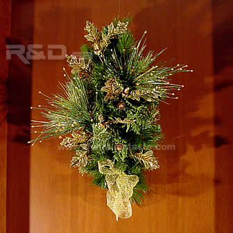 Hand-decorated pine branch for your Christmas door with golden ornaments