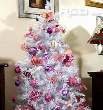 Pink ornaments for a white Christmas pine