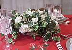 a centerpiece with roses and ivy for Christmas table