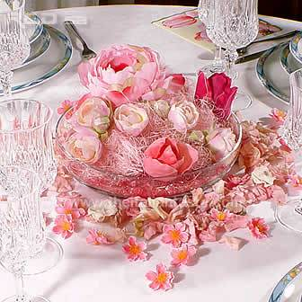 Spring table decorated with pink flowers arranged in a centerpiece