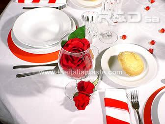 a valentine's day table with red decorations