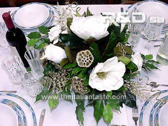 a centerpiece with silk flowers
