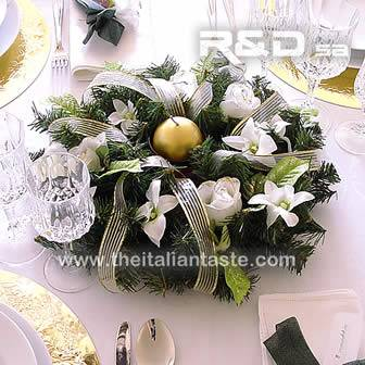 A centerpiece with pine, white roses and orchids for Christmas table