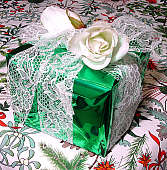 a packet with glossy paper and silk roses