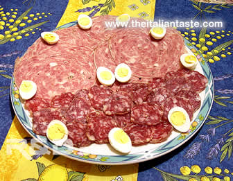 italian antipasto with salami and quail eggs