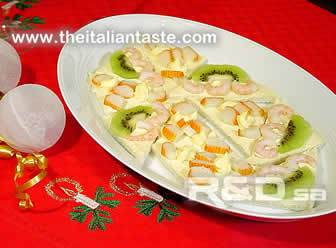 Assorted canapes garnished with kiwi fruit and prawns