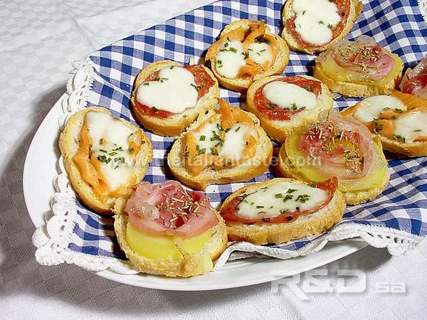 Italian crostini topped with salami, salmon and pancetta