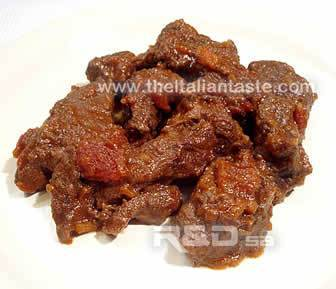Beef stew, the photo shows the beef pices on the plate in their tomato sauce