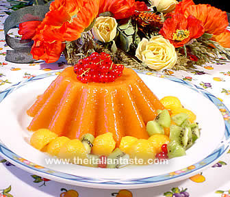 Watermelon jelly, the photo shows the whole pudding garnished with melon balls and kiwi slices
