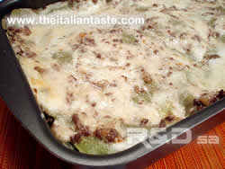bolognese lasagna in baking pan, the photo shows the surface of lasagna covered by Bolognese sauce and bechamel sauce