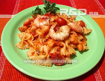 Pasta dressed with tomato and prawn sauce