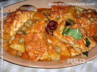 stew stockfish or stockfish calabria-style, stockfish cooked in tomato sauce with dried bell pepper