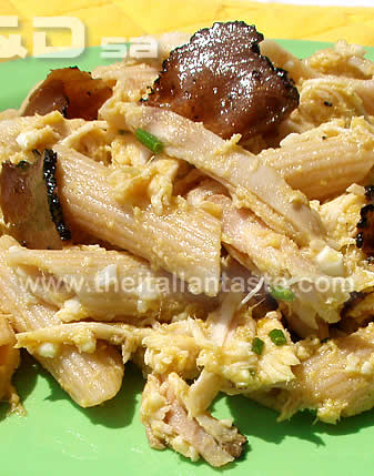 pasta salad with truffle and rabbit for special occasion menu, the photo shows a detailwith pasta combined with truffle slices and rabbit meat