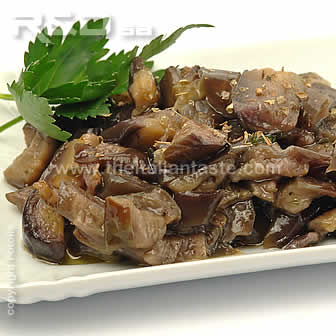 Authentic Italian recipe with eggplants cooked in oil with garlic and parsley