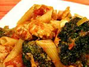 penne with broccoli and chicken breast sauce, the photo shows a detail of pasta dressed with this sauce according the pasta recipe ideas typical of South of Italy