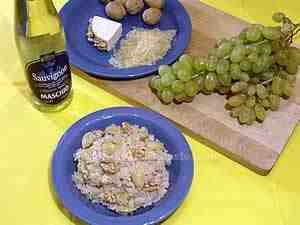 White grape risotto on a blue dish