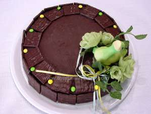 sacher torte garnished with chocolate biscuits