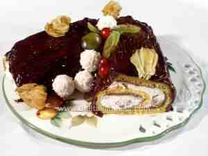 buche de Noel covered with chocolate cream and filled with chestnut cream, whipping cream and marron glacés