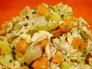 chicken salad with potatoes and carrots in a red bowl