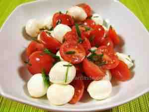 cherry tomatoes and mozzarella cheese, summer salad served in a bowl
