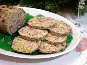 Chicken galantine, Italian recipe made with chicken and veal meat, ham and other salami, pistachios, black truffles