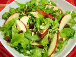 Lettuce with apples, sultanas and pine nuts