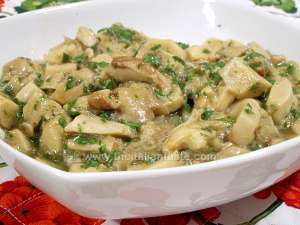 stewed mushrooms Italian style with no tomatoes in a white bowl