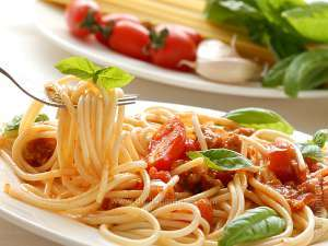italian pasta with tomato sauce and basil leaves on the top