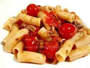 macaroni tossed with duck and tomato sauce, a tasty dish for an italian dinner party