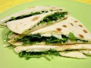 piadina filled with arugula and mozzarella cheese