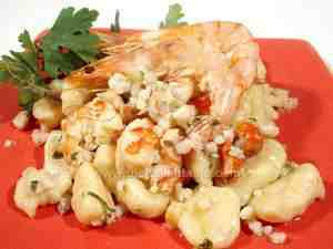 Gnocchi with scallop-and-prawn sauce , a tasty seafood dish