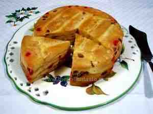 Pudding with savoiardi (lady fingers) cookies. Savoiardi biscuits are mixed with a sweet cream and candied fruits