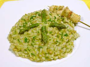 Italian risotto with asparagus and skewered scallops, a tasty dish for a celebration menu