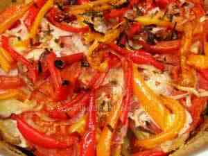 Vegetable pie with potatoes, tomatoes, bell peppers and onion