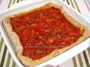 savory tart filled with salt cod mixture in a white baking pan