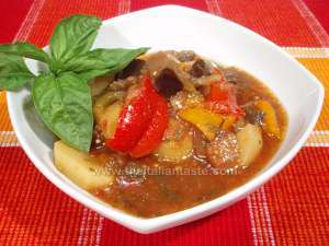 Minestrone of Apulia also called dauno, the photo shows a bowl full of minestrone whose main ingredients are sweet peppers, aubergines, potatoes and tomatoes