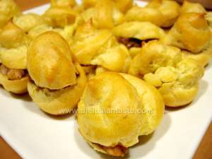 Savory cream puffs filled with mushrooms and shrimps in a white platter
