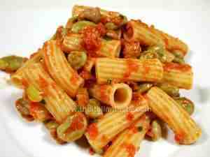 Rigatoni dressed with tomato sauce, fava beans and sausage