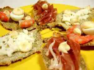 Baked breaded sage leaves garnished with quail eggs, ham and prawns