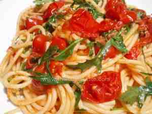 authentic italian pasta dish tossed with cherry tomatoes and arugula