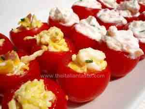 cherry tomatoes stuffed with cheese and scrambled eggs