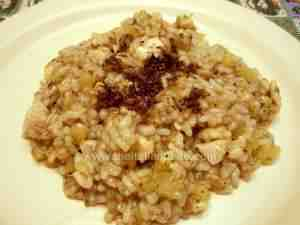 Risotto with chicken, potatoes and truffles served in a plate