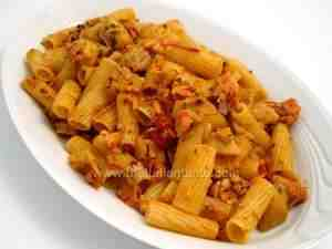 Rigatoni tossed with salmon and artichoke sauce