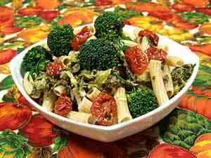 rapini pasta with tomatoes in oil