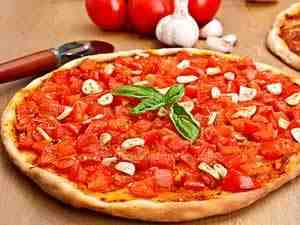 Pizza with garlic and tomatoes on the top